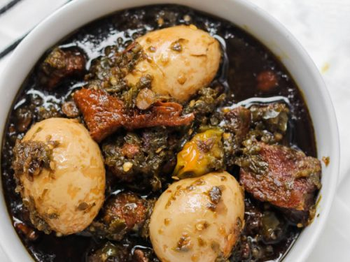 overhead shot of ayamase stew containing assorted meat and boiled eggs.