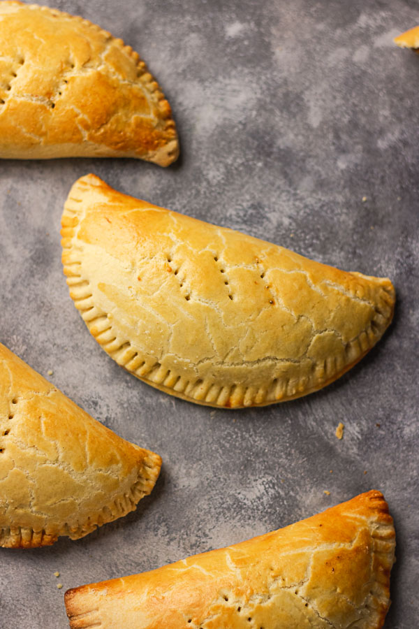 photographs of meat pies laid flat on a grey backdrop