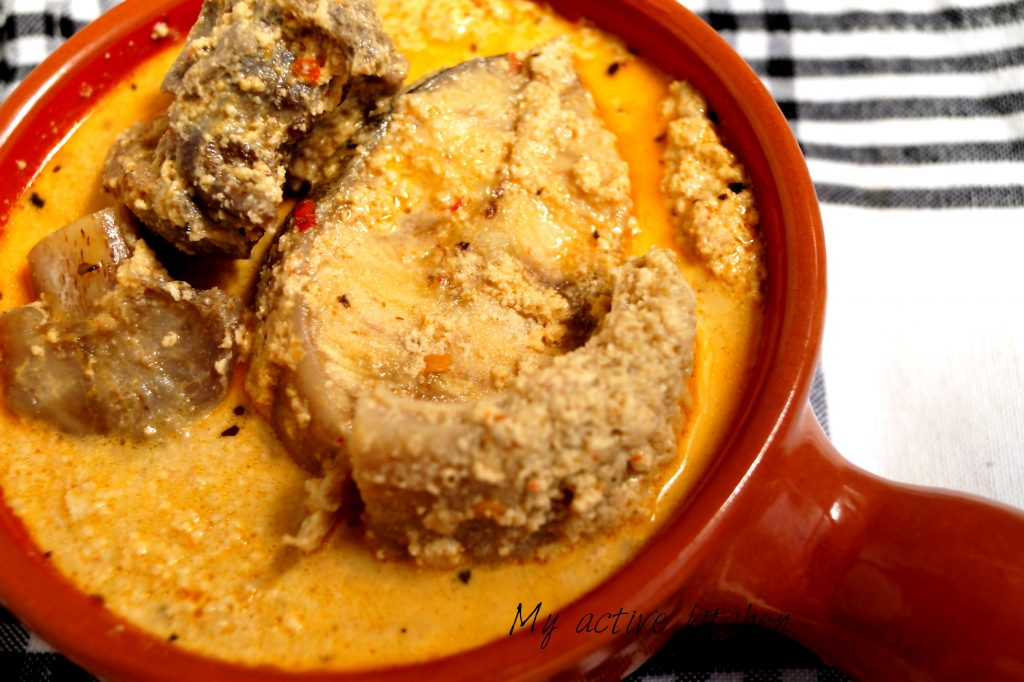 bowl of soup containing catfish and goat meat