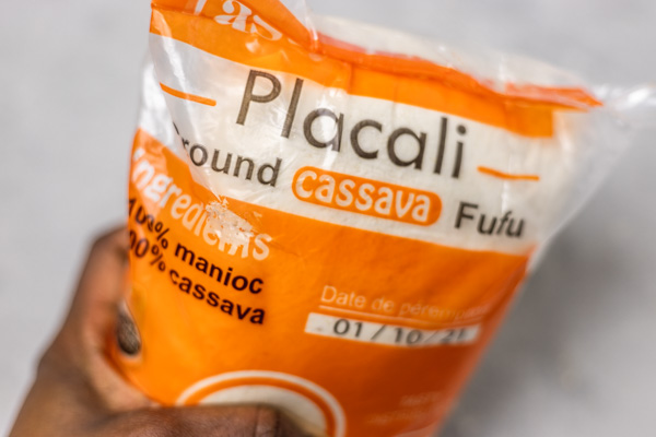 a hand holding a bag of placali.